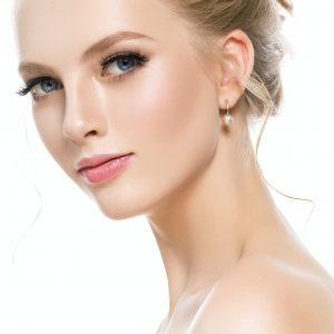 Beautiful blond hair woman close up face portrait